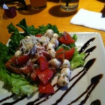 Photo taken at BJ's Restaurant & Brewhouse by Cora G. on 7/19/2013