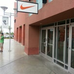 Photo taken at Nike Factory Store by Carnell S. on 7/28/2013