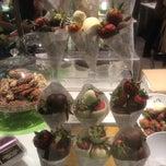 Photo taken at Godiva Chocolatier by George I. on 4/4/2015
