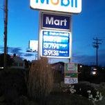 Photo taken at Mobil by Ashley M. on 6/17/2014