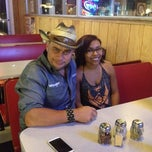 Photo taken at Pizza Como/Lou's 50 Yard Line Sports Bar by Warren R. on 10/4/2014
