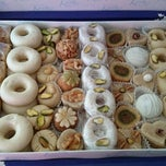 Photo taken at Kmar Patisseries Tunisienne by E G. on 9/22/2014