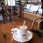 Photo taken at French Riviera Bakery & Cafe by Megan T. on 5/2/2012