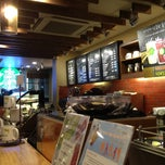 Photo taken at Starbucks by Jeongpil L. on 8/4/2012