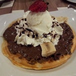 Photo taken at Crepes & Waffles by Roberto C. on 3/11/2012