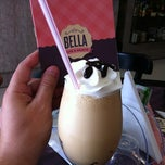 Photo taken at Bella Café by Christian S. on 3/31/2012