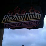 Photo taken at Blazing Onion Burger Company by Bryan B. on 1/5/2012