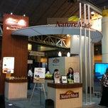 Photo taken at NatureMade Vitamin (Booth 127) by superJennifer on 3/10/2012