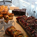 Photo taken at Parisian Patisserie Boulangerie by Nick P. on 5/27/2011
