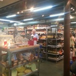 Photo taken at Monsieur Marcel Gourmet Market by Ashley W. on 7/28/2012