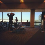 Photo taken at Gate 70 by Chris T. on 3/9/2012