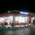 Photo taken at Five Guys Burgers & Fries by WINTER on 1/25/2012