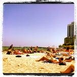 Photo taken at Oak Street Beach by Anna C. on 7/28/2012