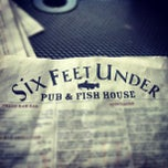 Photo taken at Six Feet Under Pub & Fish House by Jeremy T. on 8/17/2012