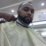 Photo taken at Dominguez Barbershop by Julio R. on 8/16/2012