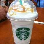 Photo taken at Starbucks by Andrea L. on 2/14/2012