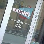 Photo taken at Interstate Kitchen & Bar by Sarah G. on 6/12/2012