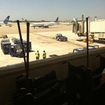 Photo taken at Gate E2 by Patricia S. on 4/8/2012