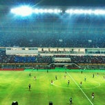 Photo taken at Stadion Utama Riau by Ricky R. on 7/13/2012