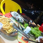 Photo taken at Grill do Josemar Picanha & Peixes by Mariana R. on 3/11/2012