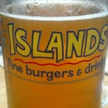 Photo taken at Islands Restaurant by Boy R. on 7/24/2012