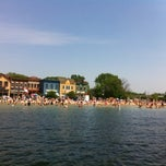 Photo taken at Pewaukee Beach by Heidi P. on 5/27/2012