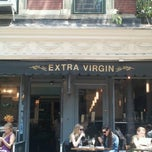 Photo taken at Extra Virgin by Melanie R. on 7/12/2012