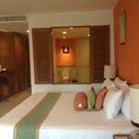 Photo taken at Ravindra Beach Resort & Spa by Supaporn S. on 8/31/2012