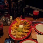 Photo taken at T.G.I. Friday's by Arturo D. on 3/3/2012
