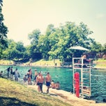 Photo taken at Barton Springs Pool by Alex L. on 5/6/2012