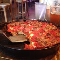 Photo taken at Pequod's Pizzeria by Michael E. on 5/22/2012