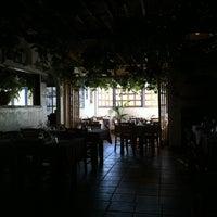 Photo taken at Koutouki Taverna by socialLITE y. on 2/15/2012