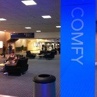 Photo taken at Gate E32 by Michael G. on 5/17/2012