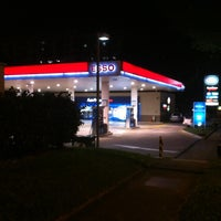 Photo taken at Esso Mobil by Carolyn W. on 6/10/2012