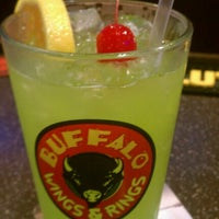 Photo taken at Buffalo Wings & Rings by Rebekah N. on 8/8/2012