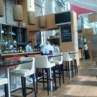 Photo taken at ely bar & brasserie by Jeremy H. on 6/20/2012