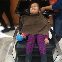 Photo taken at Rizo's Beauty Salon by Yvette M. on 11/30/2014