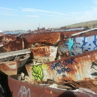 Photo taken at Staten Island Tugboat Graveyard by Emily K. on 10/14/2013