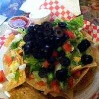 Photo taken at River Rock Cafe Inc by Kari H. on 9/19/2012
