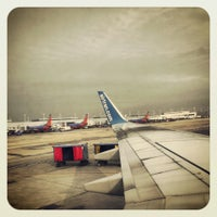Photo taken at Gate A17 by Samantha K. on 11/21/2013