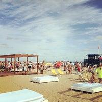 Photo taken at Bikini Beach by Bruno R. on 12/27/2012