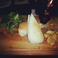 Photo taken at MUNCHIES Dine & Bar by cumiecute on 1/31/2014
