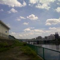 Photo taken at 神崎川河川敷 by Shinichi M. on 9/9/2013
