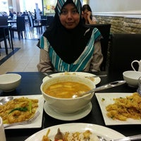 Photo taken at Wok Hei by Afiqah A. on 4/19/2013