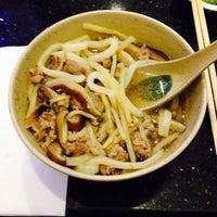 Photo taken at Sango Sushi by Cristina D. on 1/30/2014