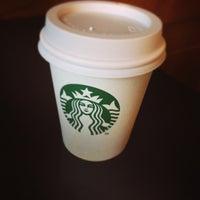 Photo taken at Starbucks by Koji S. on 8/10/2014