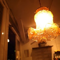 Photo taken at Umi Cafe by Tomomi S. on 4/5/2013