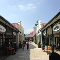 Photo taken at McArthurGlen Designer Outlet Parndorf by Tariq B. on 6/8/2013