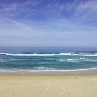 Photo taken at Sardinia Bay Beach by Jon C. on 9/23/2013