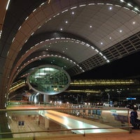 Photo taken at Dubai International Airport (DXB) by Walid A. on 10/11/2013